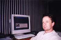 Geof Collis sitting in front of his computer